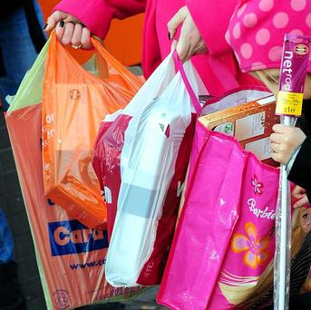 A new plastic bag levy will help reduce the 200 million shopping bags used each year, says a minister
