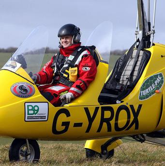 Norman Surplus, 48, from Larne, has landed his gyrocopter in Japan after days of bureaucratic wrangling