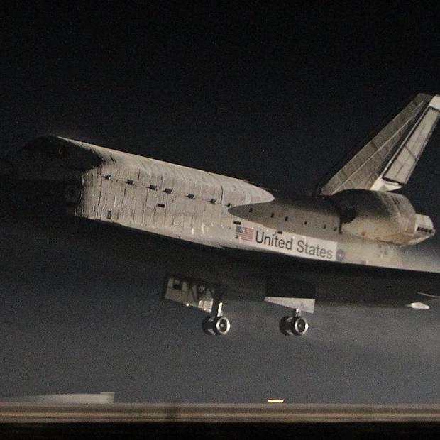 Space shuttle Atlantis lands at the Kennedy Space Centre in Cape Canaveral, Florida