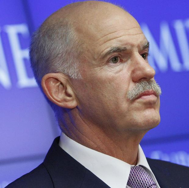 Greek prime minister George Papandreou said the agreement would help ease the burden on his country (AP)