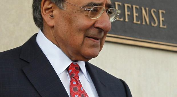 Defence Secretary Leon Panetta will end the ban on gays serving openly in America's armed services (AP)