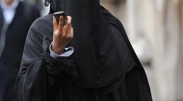 Wearing burqa-style Islamic dress in public in Belgium will be banned form Saturday