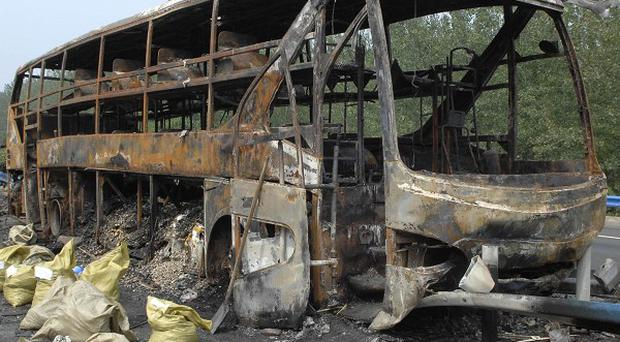 The overloaded bus burst into flames in central China, killing at least 41 people (Xinhua)
