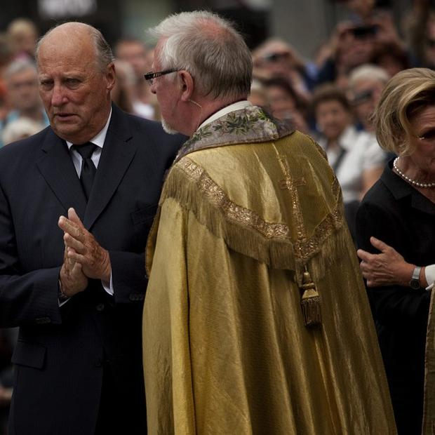 Norwegian King Harald (left) talks with Bishop Ole Christian Kvarme at the end of a memorial service at Oslo Cathedral (AP)