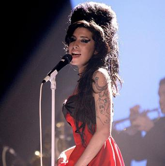 Amy Winehouse 'was devoted to her family and her friends', her father Mitch said