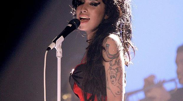Mitch Winehouse has paid tribute to his daughter Amy at her funeral