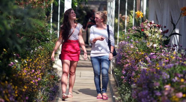 Botanic Gardens in Belfast, Abi Ballantine and Siobhan looking at the flowers in the palm house. Summer 2011