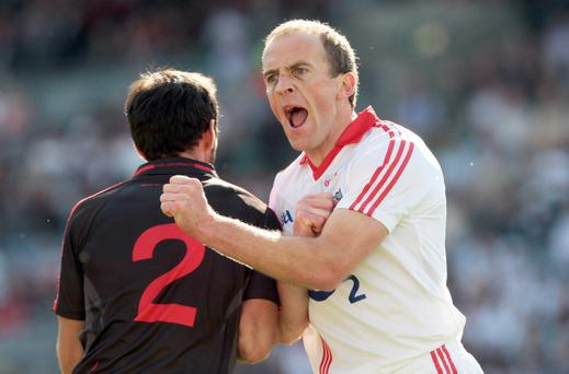 Cork's Paudie Kissane celebrates scoring a point against Down