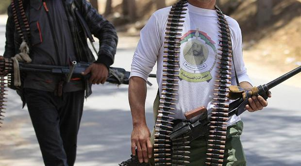 Rebel forces in Libya have seized a town along a major road, it has been claimed (AP)
