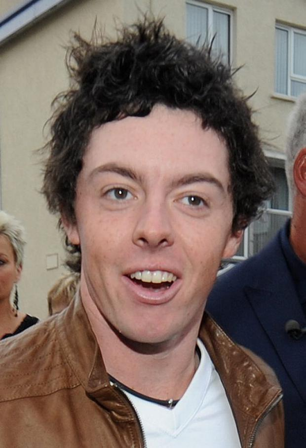19/7/2011. PACEMAKER PRESS INTL. BELFAST. Darren Clarke and Rory McIlroy arrive at the Ramore in Portrush for a private party to celebrate Clarke's British Open success. Picture Charles McQuillan/Pacemaker.
