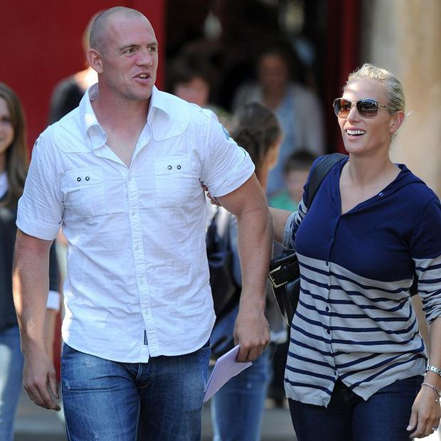 Zara Phillips and Mike Tindall outside Canongate Kirk, Edinburgh, after the rehearsal of their wedding