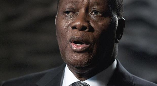 Ivory Coast President Alassane Ouattara says he knows nothing about brutal killings committed by his forces the day after his inauguration (AP)