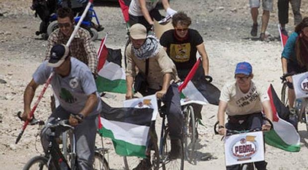 A group of UK activists has arrived in the West Bank after cycling 7,000km from London