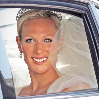 Zara Phillips in a car on the Royal Mile after emerging from Canongate Kirk in Edinburgh after her wedding to Mike Tindall