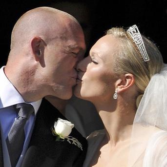 Zara Phillips and her new husband Mike Tindall kiss outside Canongate Kirk in Edinburgh after their wedding
