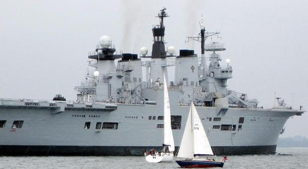 HMS Illustrious arriving in Southampton Water ahead of the start of the Clipper Round the World yacht race