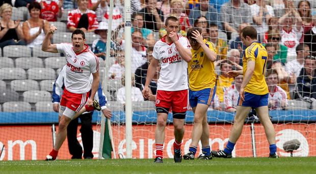 Sean Cavanagh was on target for Tyrone as the Red Hands sealed an 11-point win over Roscommon at Croke Park, booking a quarter-final date with Dublin