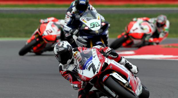 Eugene Laverty pushed Carlos Checa all the way at Silverstone but it was the Spanish star who grabbed a double World Superbikes victory