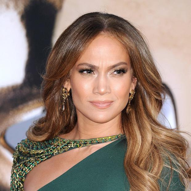 Jennifer Lopez's first husband wants to use portions of more than 11 hours of home videos of him and the superstar for a movie