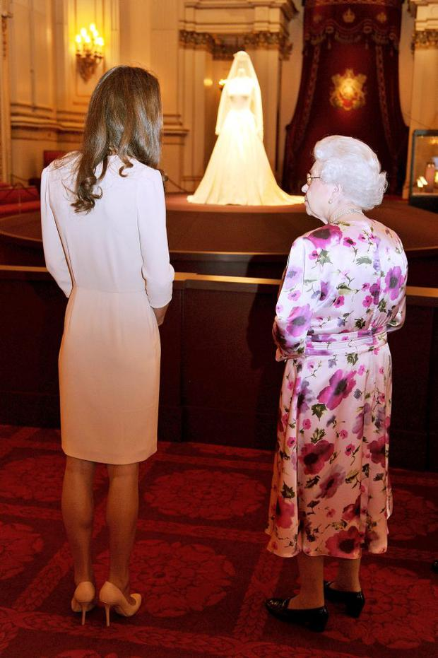 Queen Elizabeth II and Catherine, Duchess of Cambridge view the exhibitions for the summer opening of Buckingham Palace