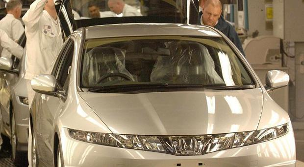 Honda's quarterly profit plunged nearly 90 per cent because of sales damage from the earthquake in north-eastern Japan