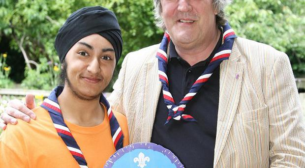 Stephen Fry receives an Honorary Scout Badge for IT from Simrit Kudhail, a Scout from Uxbridge