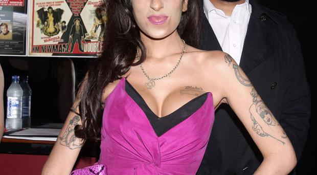 Amy Winehouse's family are waiting learn what caused her death