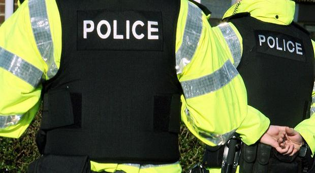 A man has been attacked by a gang armed with iron bars in west Belfast, police said