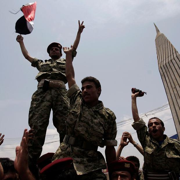 Defected soldiers salute during a protest demanding the resignation of Yemen's president Ali Abdullah Saleh in Sanaa, Yemen (AP)