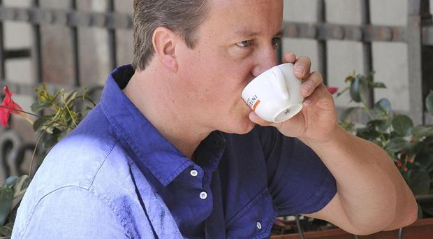 A barmaid has made a name for herself, but no tip, after telling David Cameron he could carry his own cappuccino