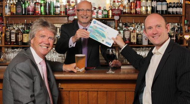 Mr Neill (centre) joined Terry Loughins (left) and Andy Ferguson from Barclaycard to welcome the important partnership.