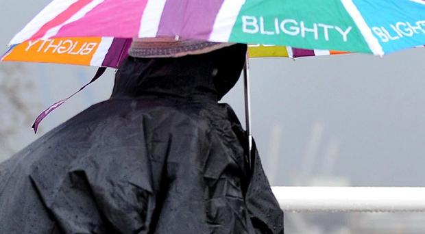 Umbrellas are replacing parasols as the hot weather gives way to bursts of heavy rain