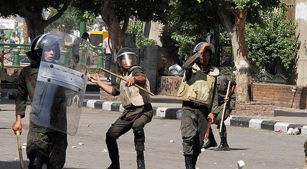Soldiers advance to remove protesters camping out in Tahrir Square in Cairo, Egypt (AP)