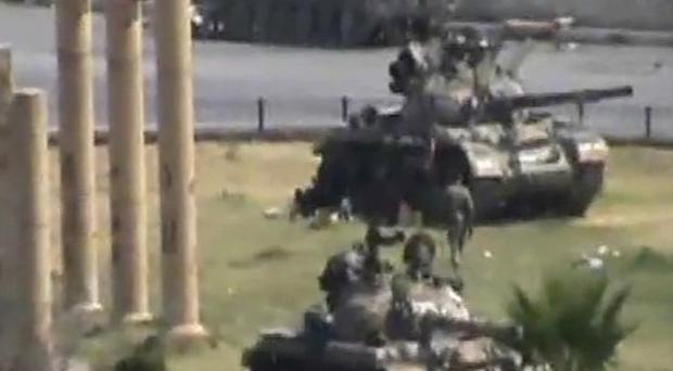 Amateur image reportedly of military armoured vehicles in the Syrian city of Hama (AP Photo/APTN)