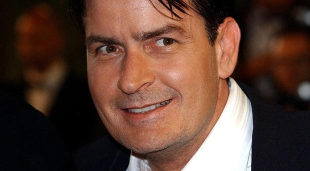 A judge has granted Charlie Sheen's request to dismiss a lawsuit against a woman who locked herself in a hotel room he had left in tatters