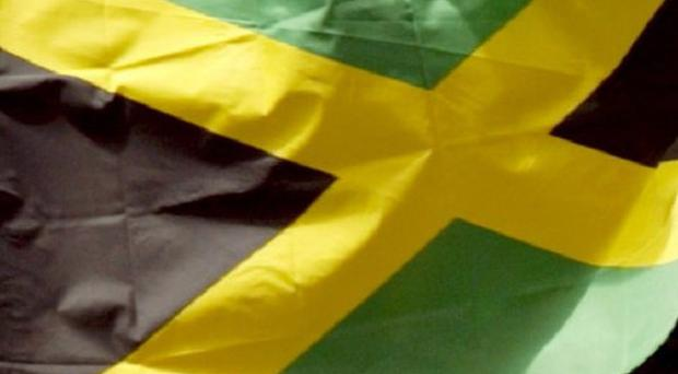 Three people have been arrested over the beheading of a mother and daughter at their home in Jamaica