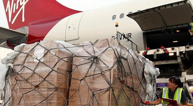 Emergency aid from Unicef is loaded on to a Virgin Atlantic flight to Nairobi at London's Heathrow Airport to transport the aid to Somalia