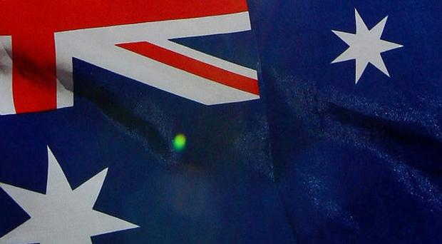 A woman is apparently trapped at her home in Australia fastened to a bomb