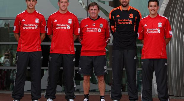 Liverpool signings (left to right) Jordan Henderson, Charlie Adam, manager Kenny Dalglish, Alexander Doni and Stewart Downing pose at Melwood Training Ground yesterday