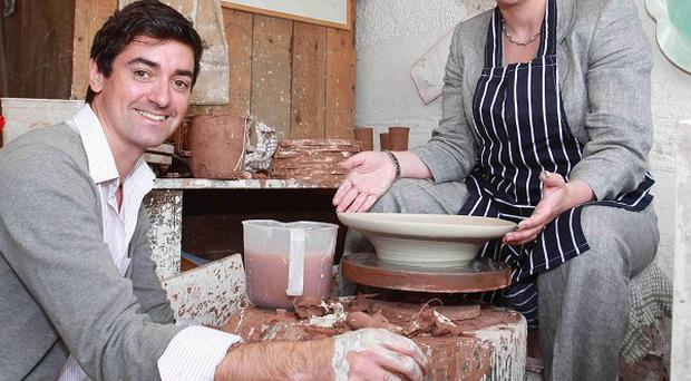 Tourism minister Arlene Foster and potter Stephen Farnan at the Priory Cottages Art, Craft and Design Studios in Benburb