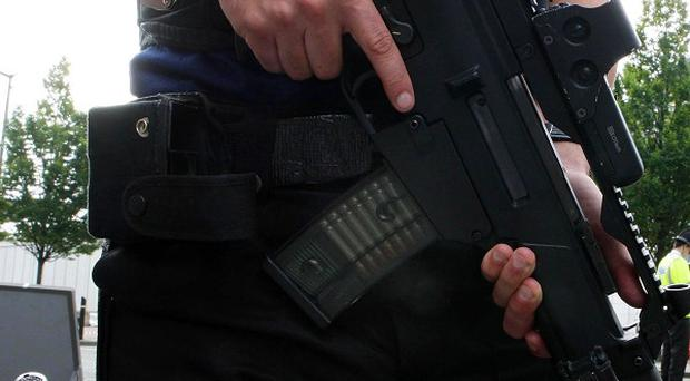 Five police officers from an elite gun crime unit were sacked after a photo emerged of them 'behaving inappropriately'
