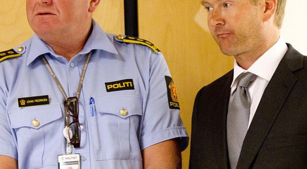 Prosecutor Christian Hatlo (right) said gunman Anders Behring Breivik was withholding information from investigators (AP)