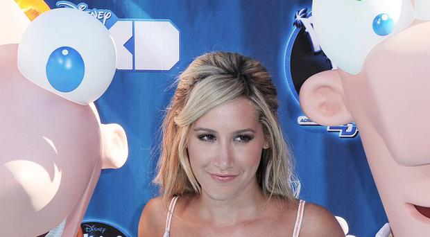 Ashley Tisdale stepped out at the Phineas And Ferb film premiere without her British co-star Thomas Sangster