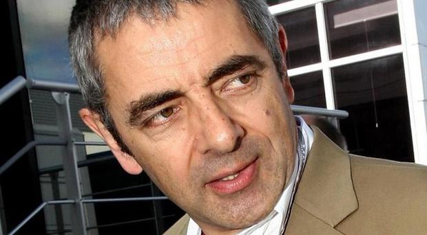 Rowan Atkinson was taken to hospital after his car crashed, according to reports