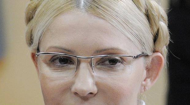 Police arrested Yulia Tymoshenko during her abuse-of-office trial for violations of court procedures (AP)