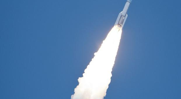 An Atlas V rocket launches with the Juno spacecraft payload from Cape Canaveral in Florida (Nasa/AP)