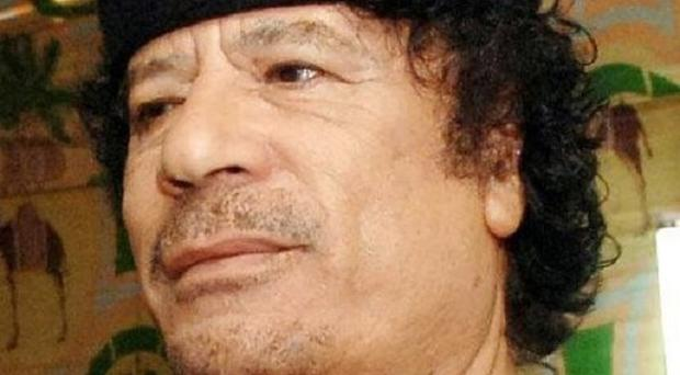 Muammar Gaddafi's youngest son Khamis is still alive, the Libyan government has insisted
