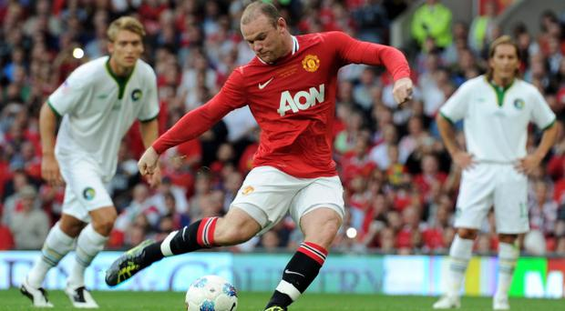 MANCHESTER, ENGLAND - AUGUST 05: Wayne Rooney of Manchester United scores his team's second goal from a penalty during Paul Scholes' Testimonial Match between Manchester United and New York Cosmos at Old Trafford on August 5, 2011 in Manchester, England. (Photo by Chris Brunskill/Getty Images)