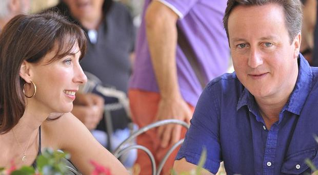 Downing Street says there are no plans for Prime Minister David Cameron to cut short his family holiday in Italy