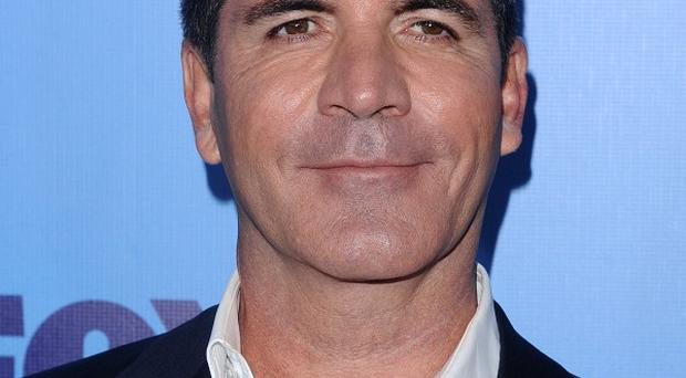 Simon Cowell says the winner of the US X Factor will get a 5 million dollar cash prize (AP)